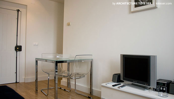Living and dining of the 2 bedroom apartment in Chiado, Lisbon