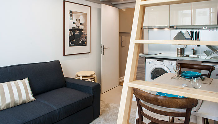 Living and dining room of the 1 bedroom apartment with mezzanine in Chiado, Lisbon